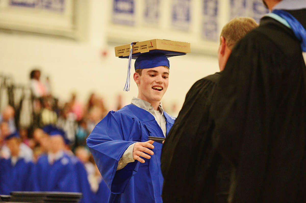 Hour photo / Erik Trautmann Wilton High School senior Walter Winrow receives his diploma during the Class of 2015 commencement ceremonies Saturday.