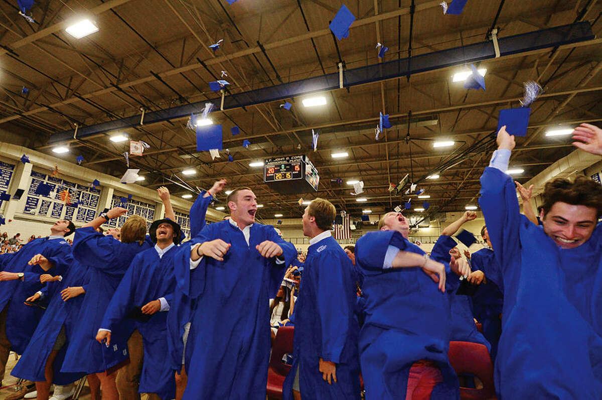 Hour photo / Erik Trautmann Wilton High School seniors celebrate during the Class of 2015 commencement ceremonies Saturday.