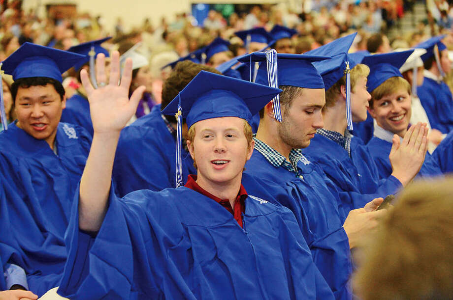 Hour photo / Erik Trautmann Wilton High School students celebrate during the Class of 2015 commencement ceremonies Saturday.