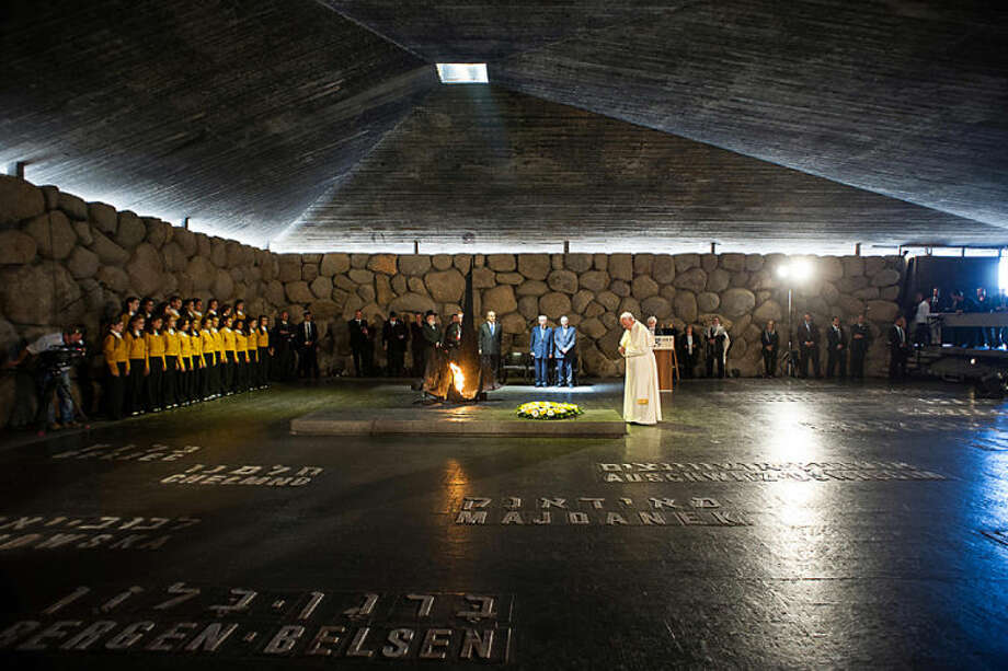 In this photo provided by the Vatican newspaper L'Osservatore Romano, Pope Francis lays a wreath at the Hall of Remembrance at the Yad Vashem Holocaust memorial in Jerusalem, Monday, May 26, 2014. (AP Photo/L'Osservatore Romano, ho)