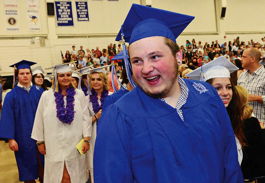 Hour photo / Erik Trautmann Wilton High School seniors including Nicholas Osmun celebrate during the Class of 2015 commencement ceremonies Saturday.
