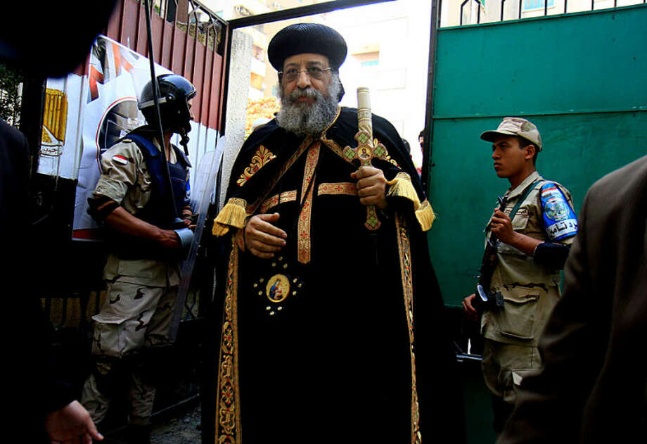 Coptic Pope Tawadros II enters a polling station to cast his ballot on the first day of the presidential elections in Cairo, Egypt, Monday, May 26, 2014. Egyptians were choosing a new president on Monday in an election likely to be won by retired military chief Field Marshal Abdel-Fattah el-Sissi who nearly a year ago ousted the nation's first freely elected president, the Islamist Mohammed Morsi. El-Sissi is practically assured of a victory in the vote, which is being held over two days, Monday and Tuesday. The only other candidate in the race is leftist politician Hamdeen Sabahi, who finished third in the 2012 presidential election. (AP Photo/Ahmed Ramadan)