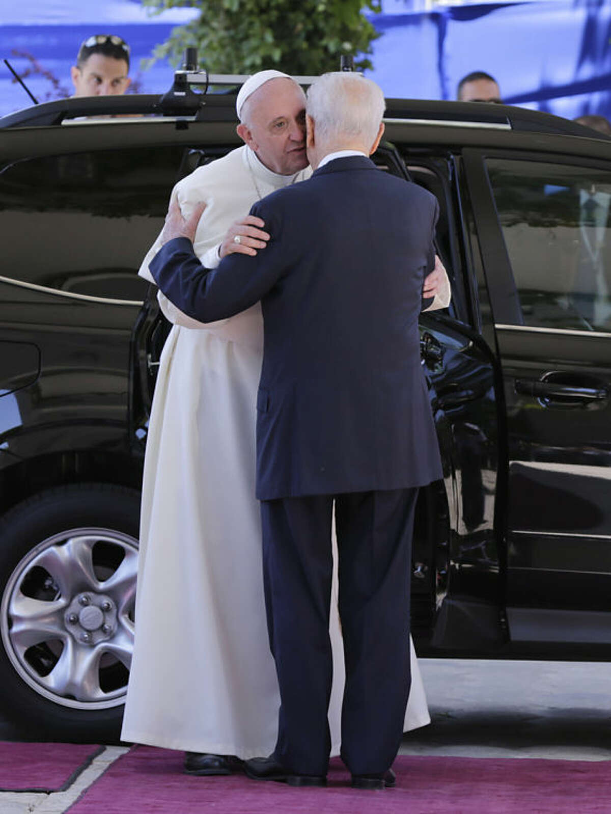Pope Francis meets Israeli President Shimon Peres in Jerusalem on Monday, May 26, 2014. Pope Francis is paying a three-day visit to Jordan, West Bank and Israel. Francis honored Jews killed in the Holocaust, kissing the hands of six survivors in an emotional ceremony at Israel's national Holocaust memorial on Monday as he capped a Mideast trip with poignant stops at some of the holiest and most haunting sites for Jews. (AP Photo/Tsafrir Abayov, Pool)