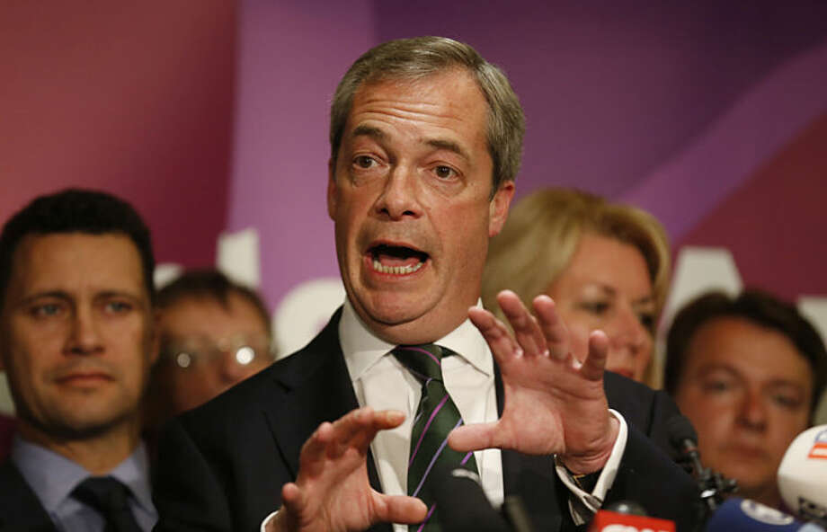 Nigel Farage, leader of the UK Independence Party and newly re-elected MEP, speaks to the media during a post European Elections press conference in central London, Monday, May 26, 2014. (AP Photo/Sang Tan)
