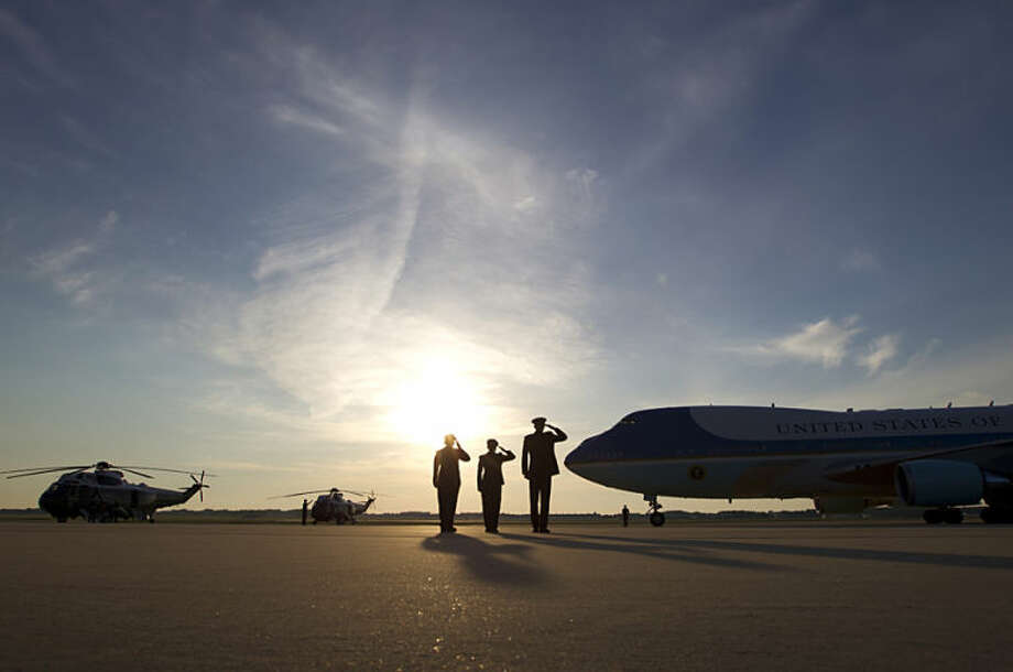 Military personnel salute Air Force One upon arrival President Barack Obama's arrival at Andrews Air Force Base, Md. on Monday, May 26, 2014. Obama is returning from an unannounced visit to the troops in Afghanistan. (AP Photo/Jose Luis Magana)