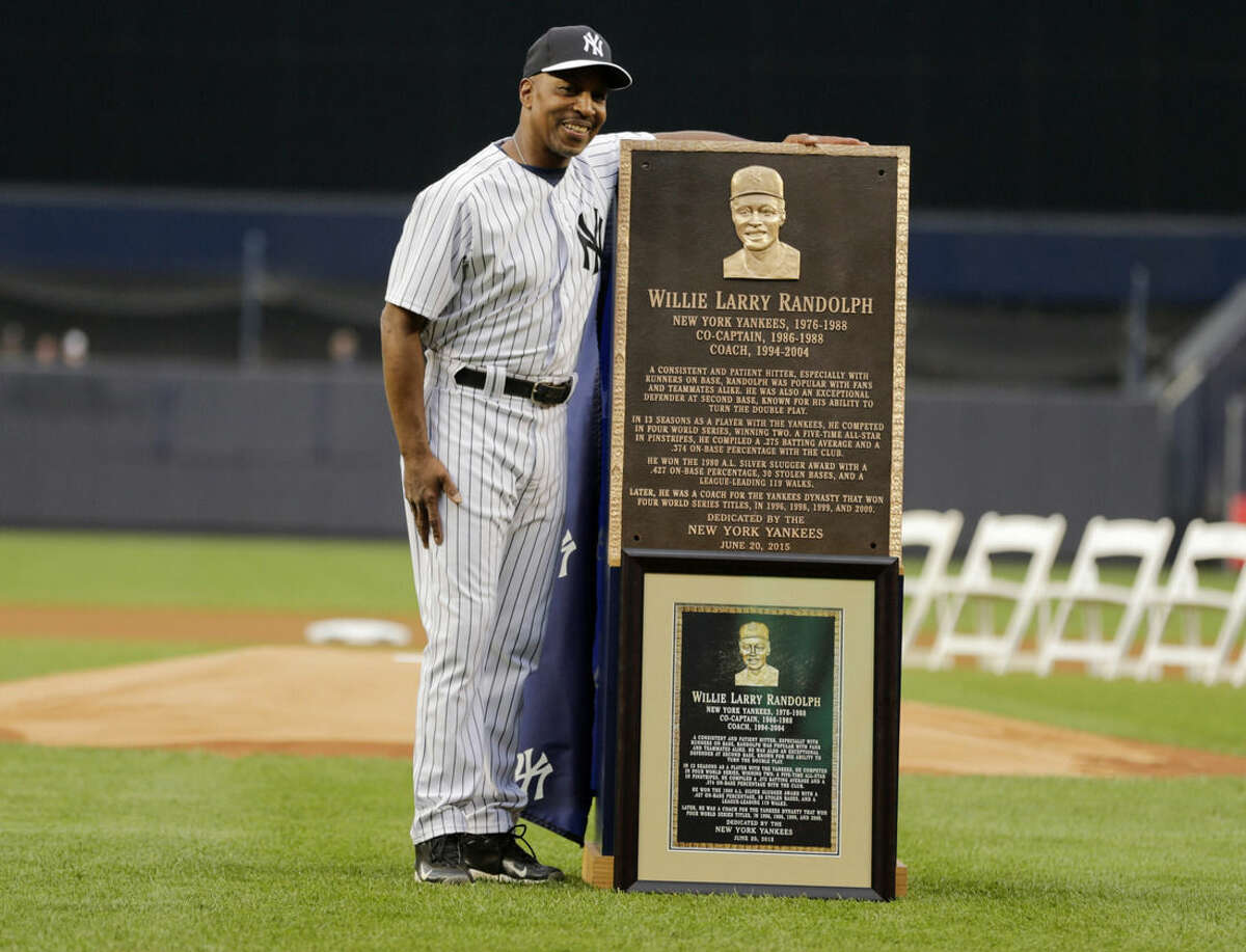 Willie Randolph poses for photograph with a plaque he was awarded during opening ceremonies for the Old-Timers' Day baseball game Saturday, June 20, 2015, at Yankee Stadium in New York. (AP Photo/Frank Franklin II)