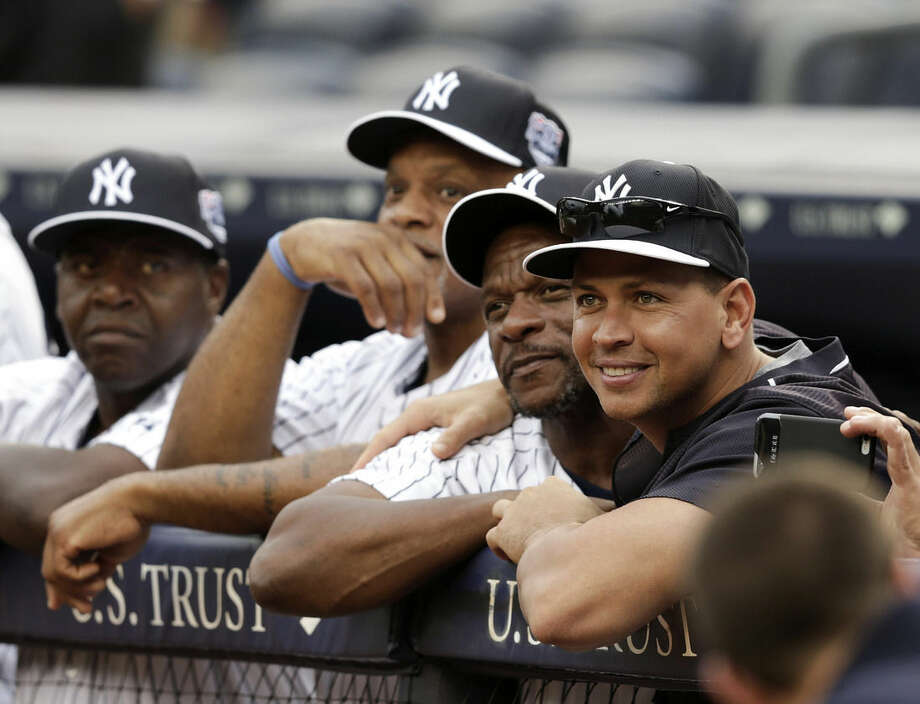 New York Yankees' Alex Rodriguez, right, and former player Rickey Henderson, second from right, join other former players as they watch Willie Randolph speak opening ceremonies for the Old-Timers' Day baseball game Saturday, June 20, 2015, at Yankee Stadium in New York. (AP Photo/Frank Franklin II)