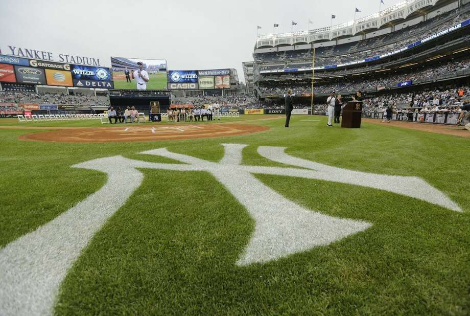 Former New York Yankees player Willie Randolph speaks to fans during opening ceremonies for the Old-Timers' Day baseball game Saturday, June 20, 2015, at Yankee Stadium in New York. (AP Photo/Frank Franklin II)