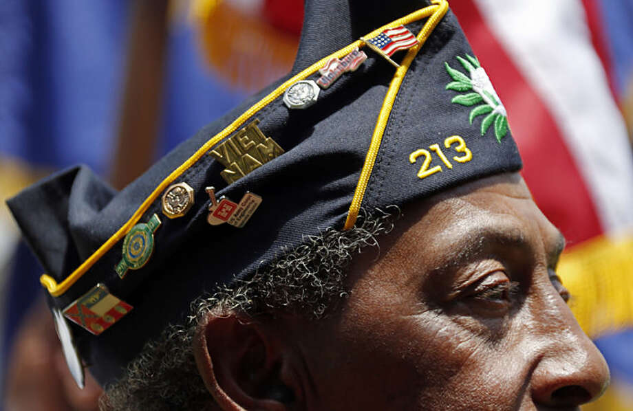 American Legion member Richard Clark, wearing his association pins on his cover, participates in the annual Memorial Day observances at the Vicksburg National Cemetery, Monday, May 26, 2014, in Vicksburg, Miss. (AP Photo/Rogelio V. Solis)