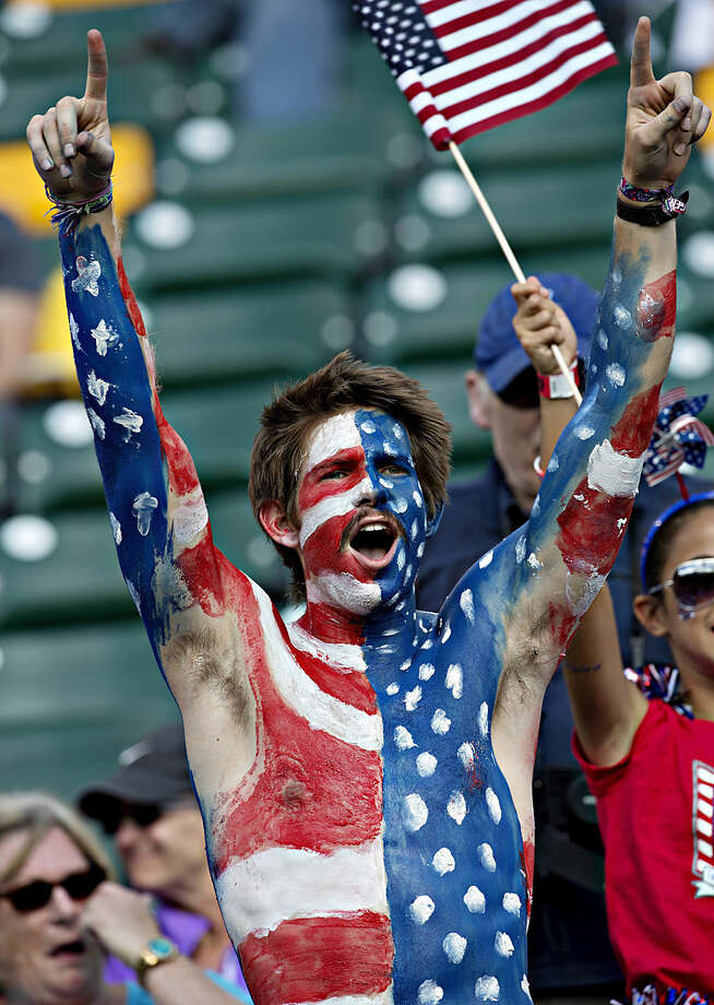 United States fans cheer for their team before the FIFA Women's World Cup round of 16 action against Colombia in Edmonton, Alberta, Monday June 22, 2015. (Jason Franson/The Canadian Press via AP) MANDATORY CREDIT