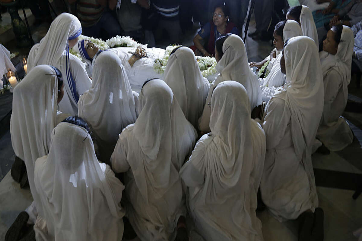 Nuns pray as they surround the body of Sister Nirmala Joshi, who succeeded Mother Theresa as the head of the Missionaries of Charity, in Kolkata, India, Tuesday, June 23, 2015. The 81-year-old nun, whose health had been declining in recent days, died early Tuesday. (AP Photo/Bikas Das)