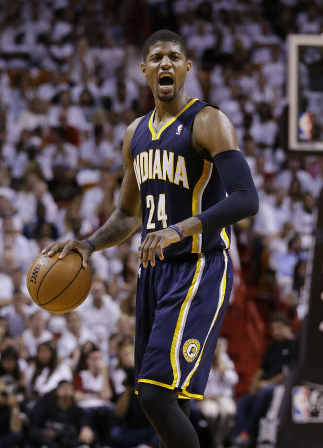 Indiana Pacers forward Paul George (24) shouts during the first half of Game 4 in the NBA basketball Eastern Conference finals playoff series against the Miami Heat, Monday, May 26, 2014, in Miami. (AP Photo/Wilfredo Lee)