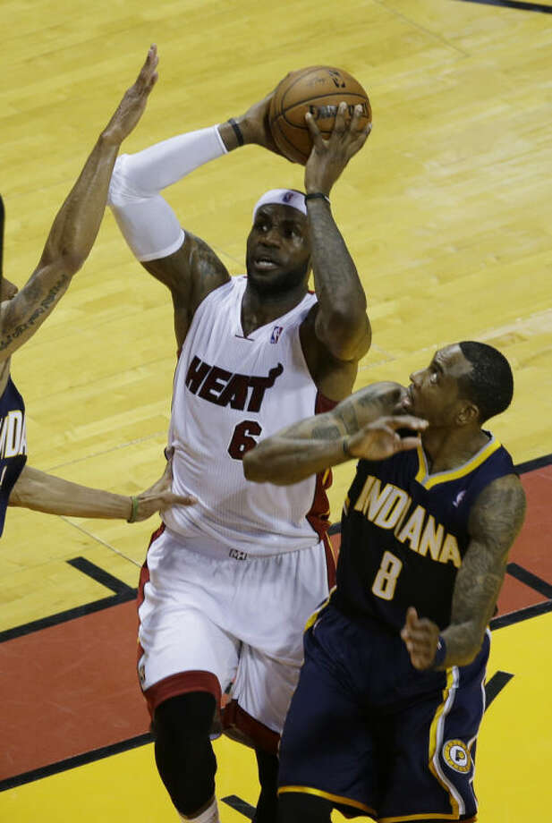 Miami Heat forward LeBron James (6) drives to the basket past Indiana Pacers guard Rasual Butler (8), during the first half of Game 4 in the NBA basketball Eastern Conference finals playoff series, Monday, May 26, 2014, in Miami. (AP Photo/Lynne Sladky)