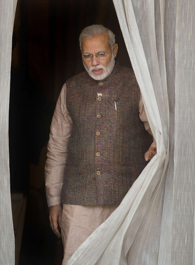 India's new Prime Minister Narendra Modi, comes out during his meeting with South Asian leaders, in New Delhi, India, Tuesday, May 27, 2014. Modi met with the leaders of rival Pakistan and other neighboring nations on Tuesday, a day after being sworn in. (AP Photo /Manish Swarup)