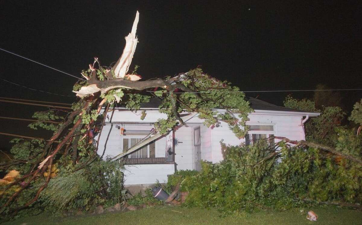 A house on Bray Road north of Birch Run Road in Tuscola County's Arbela Township was damaged by a tornado that swept through Saginaw and Tuscola Counties Monday night, June 22, 2015. (Jeff Schrier/The Saginaw News/MLive.com via AP)