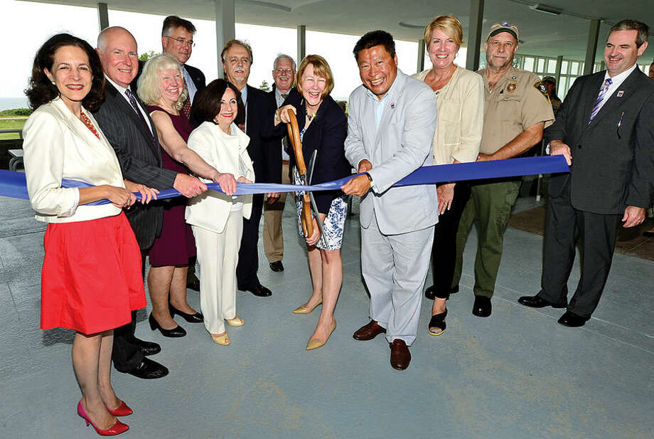 Hour photo / Erik Trautmann Local officials including State Representative Gail Lavielle, Westport First Seleman Jim Marpe, Friends of Sherwood Island President, LIz-Ann Koos, State Repersentative John Shaban, State Senator Toni Boucher, DAS Deputy Commissioner Bud Salemi, DAS project manager Lee Rowley, CT DEEP Deputy Commsioner Susan Whalen, State Representative Tony Huang, State Representative Laura Devlin, Park Supervisor Jim Beschle, and Director of CT State Parks Tom Tyler , cut the ribbon during a ceremony for the newly renovated Sherwood Island State Park Pavilion Tuesday afternoon.