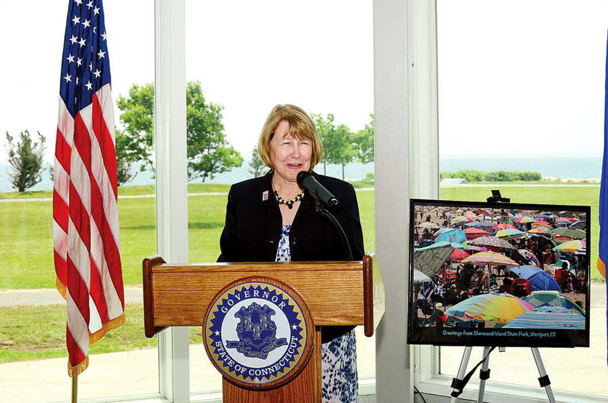 Hour photo / Erik Trautmann CT DEEP Deputy Commsioner Susan Whalen addresses State Park advocates and officials during aceremony for the newly renovated Sherwood Island State Park Pavillion Tuesday afternoon.