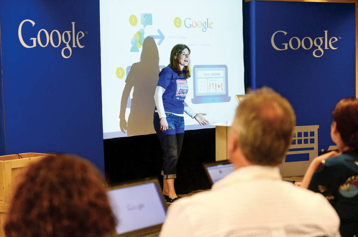 Hour photo / Erik Trautmann Anastasia Kudres teaches small business owners how to reach more customers online during the Google for a Connecticut Get Your Business Online event at Dolce Norwalk Tuesday.