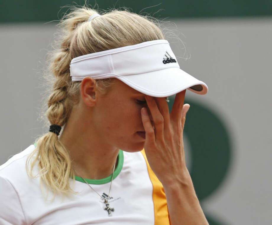 Denmark's Caroline Wozniacki wipes her face during the first round match of the French Open tennis tournament against Belgium's Yanina Wickmayer at the Roland Garros stadium, in Paris, France, Tuesday, May 27, 2014. (AP Photo/Darko Vojinovic)
