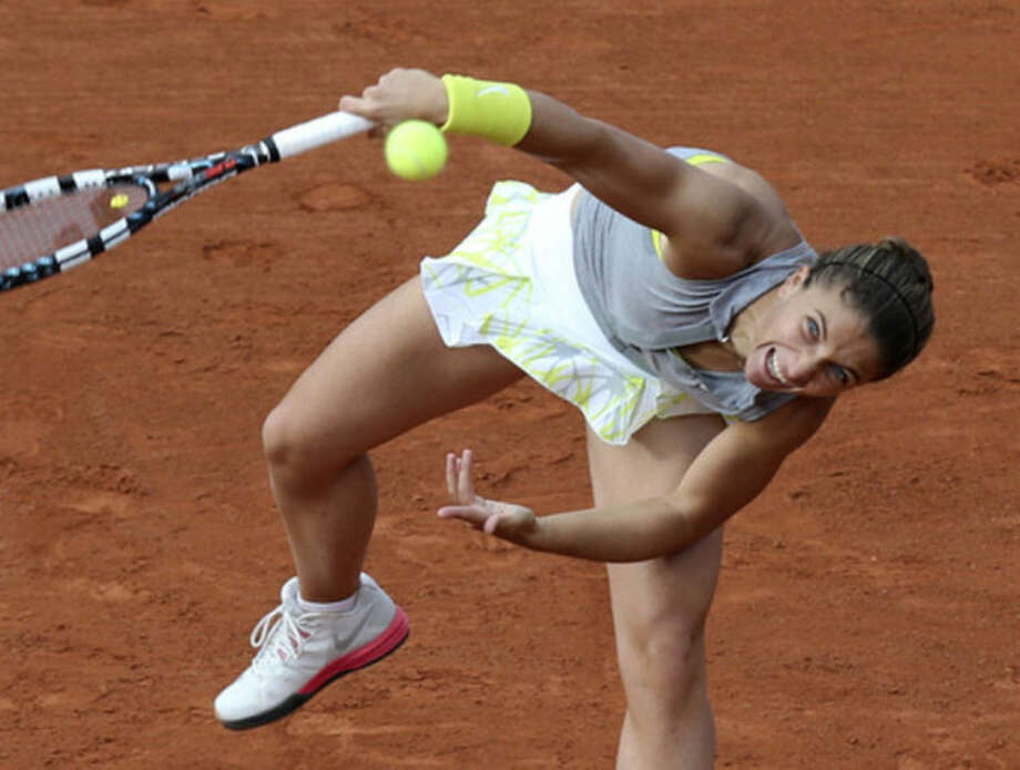 Italy's Sara Errani serves to Madison Keys, of the U.S, during the first round match of the French Open tennis tournament at the Roland Garros stadium, in Paris, France, Tuesday, May 27, 2014. (AP Photo/David Vincent)