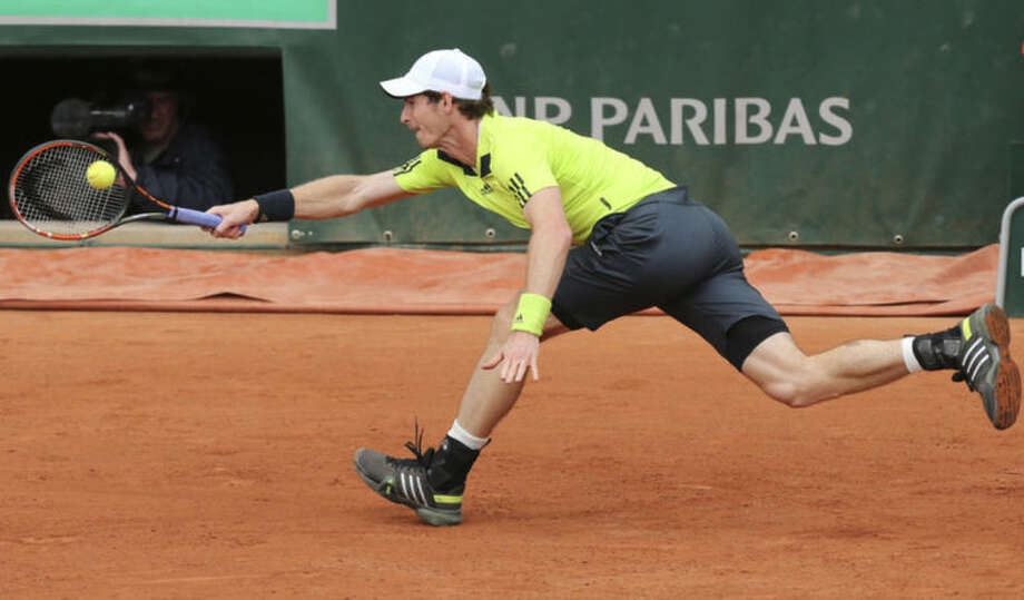 Britain's Andy Murray tries to return the ball to Kazakhstan's Andrey Golubev during the first round match of the French Open tennis tournament at the Roland Garros stadium, in Paris, France, Tuesday, May 27, 2014. (AP Photo/David Vincent)