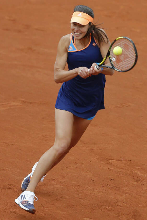 Serbia's Anna Ivanovic returns the ball during the first round match of the French Open tennis tournament against France's Caroline Garcia at the Roland Garros stadium, in Paris, France, Tuesday, May 27, 2014. (AP Photo/Michel Spingler)