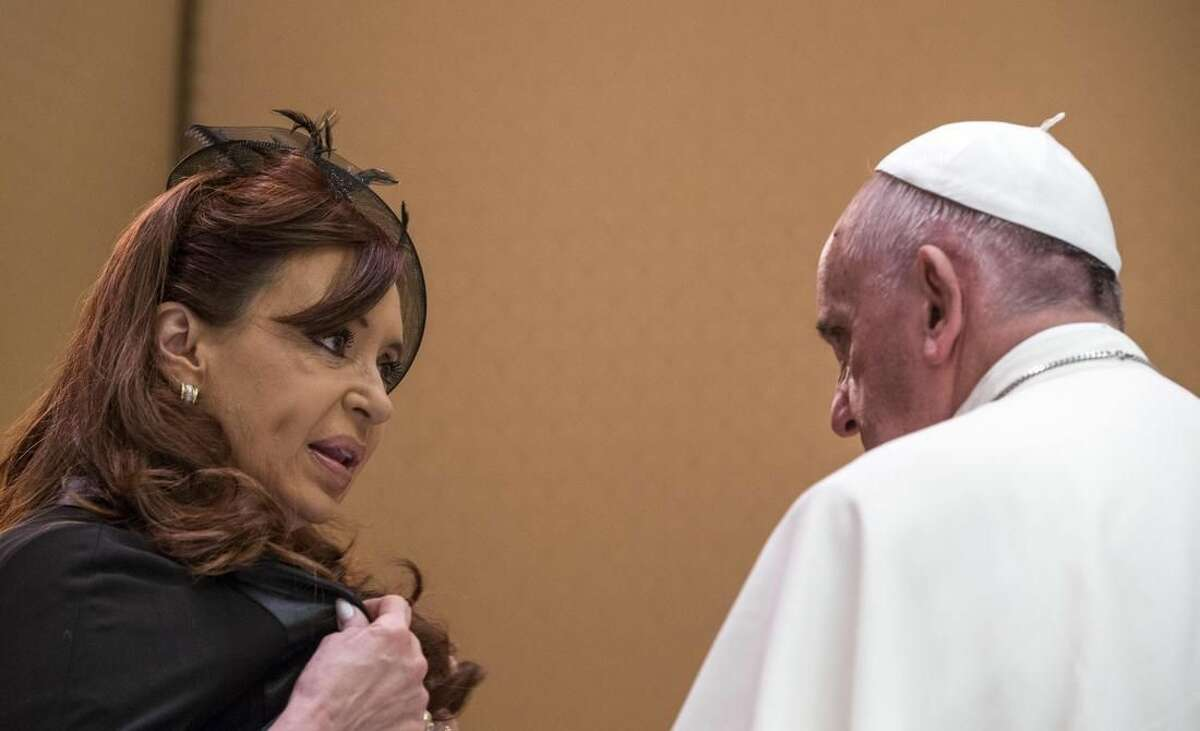 FILE - In this June 7, 2015, file photo, Argentina's President Cristina Fernandez, left, shares a word with Pope Francis on the occasion of a private audience at the Vatican. Francis recently complained during an interview with Mexican television station Noticieros Televisa that he felt