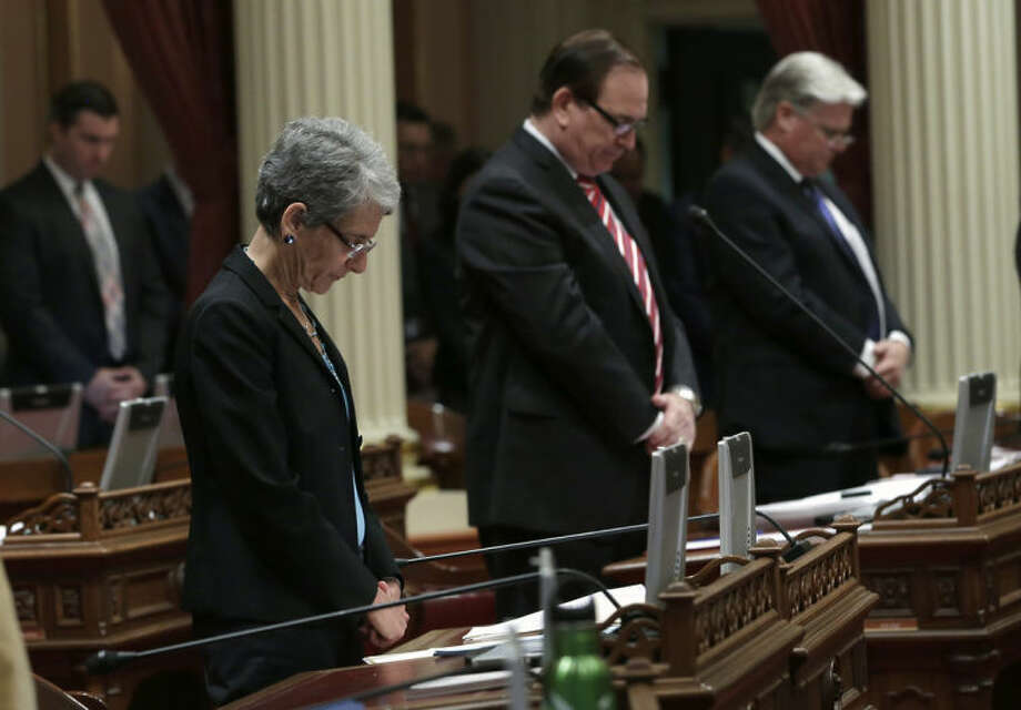 State Sen. Hannah-Beth Jackson, D-Santa Barbara, who represents the community of Isla Vista where six young people were killed on Friday, May 23, leads senators in a moment of silence in their memory, at the Capitol in Sacramento, Calif., Tuesday, May 27, 2014. Lawmakers say the state Legislature needs to do more to deter the type of violence carried out by 22-year-old Elliot Rodger, who killed six people and injured 13 others in the shooting and stabbing attacks Friday night in the Isla Vista community near campus of the University of California, Santa Barbara. (AP Photo/Rich Pedroncelli)