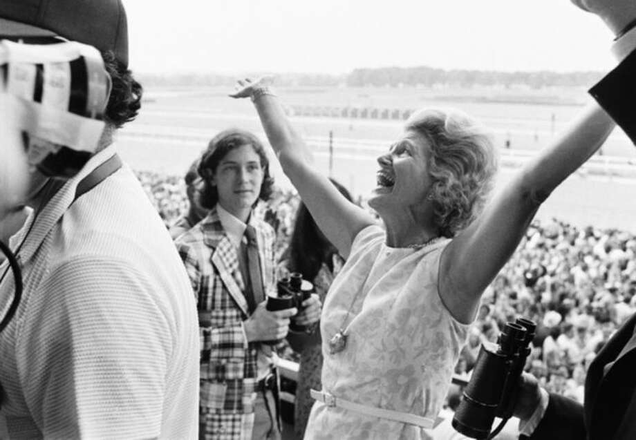 FILE - This June 9, 1973 file photo shows Penny Chenery, owner of Secretariat, reacting after her horse won the Belmont Stakes, and the Triple Crown, at Belmont Park in Elmont, N.Y. Kentucky Derby and Preakness Stakes winner California Chrome is at Belmont Park in Elmont, N.Y., preparing for the final leg of the Triple Crown. (AP Photo/Jack Kanthal, File)