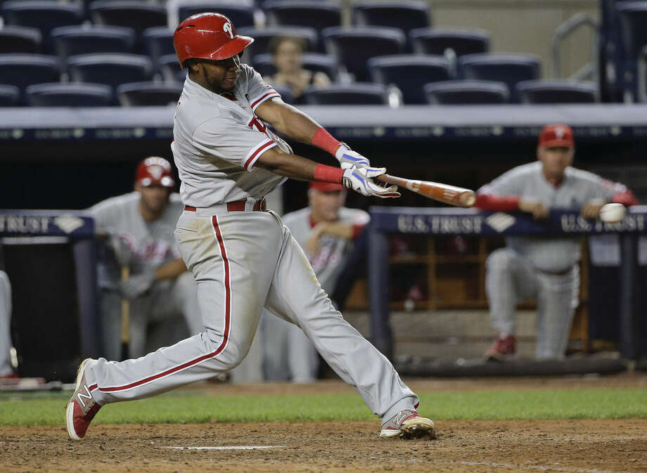 Philadelphia Phillies' Maikel Franco doubles down the third base line to drive in two runs against the New York Yankees during the ninth inning of a baseball game, Tuesday, June 23, 2015, in New York. (AP Photo/Julie Jacobson)