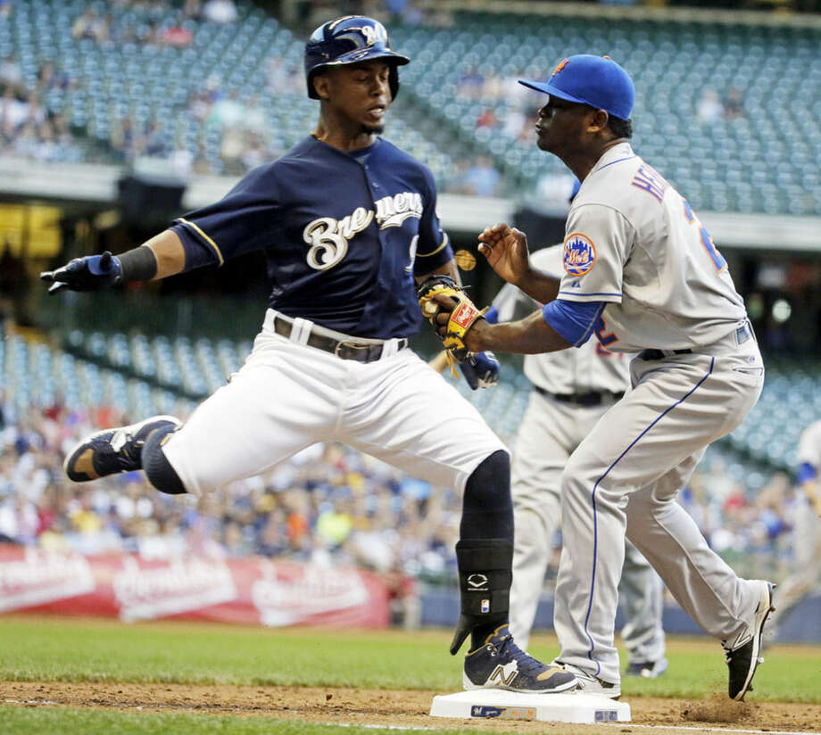 Milwaukee Brewers' Jean Segura collides with New York Mets second baseman Dilson Herrera at first during the second inning of a baseball game Tuesday, June 23, 2015, in Milwaukee. Both players were shaken up on the play. (AP Photo/Morry Gash)