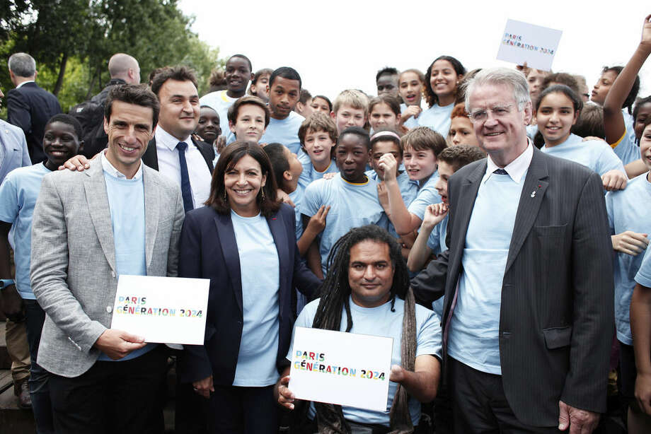 From left, Olympic champion Tony Estanguet, Paris mayor Anne Hidalgo, Paralympic champion Ryadh Sallem and President of the International Rugby Federation Bernard Lapasset, pose for a picture during a gathering as part of the official launch for the Paris bid for the 2024 Olympics, Tuesday, June 23, 2015. Paris declared its candidacy for the 2024 Olympics on Tuesday, becoming the fourth city to enter the race and setting out its vision for bringing the games back to the French capital for the first time in 100 years. (AP Photo/Thibault Camus)