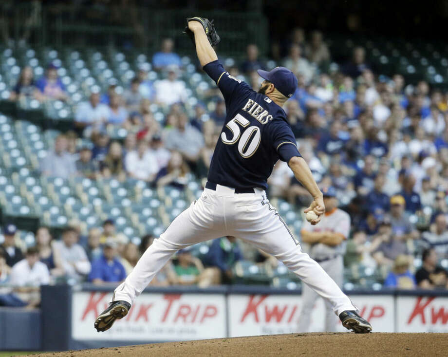 Milwaukee Brewers starting pitcher Mike Fiers throws during the first inning of a baseball game against the New York Mets Tuesday, June 23, 2015, in Milwaukee. (AP Photo/Morry Gash)
