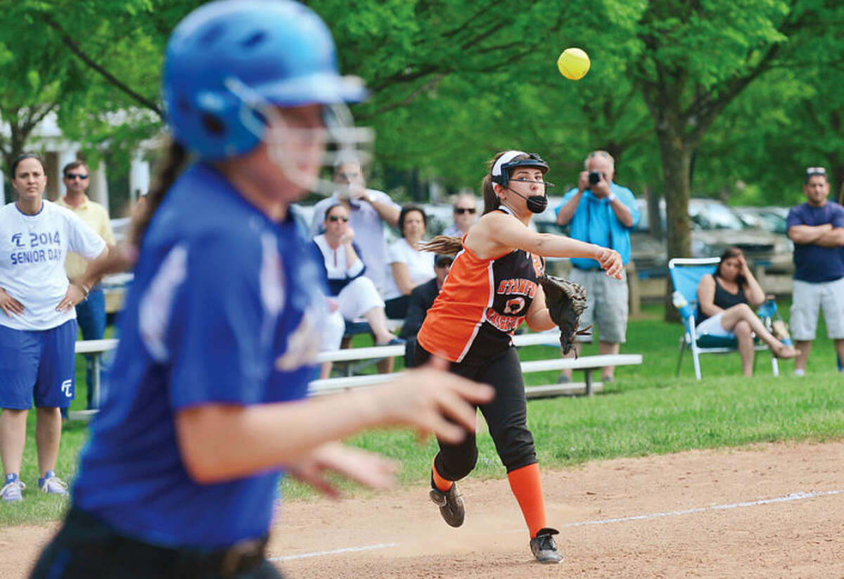 Stamford High's Haley LaMotta throws out a runner from third in the FCIAC game against Fairfield Ludlowe Tuesday.