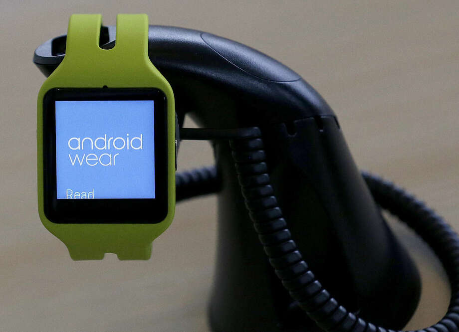 "In this May 28, 2015 photo, an Android Wear smartwatch is on display at Google I/O 2015 in San Francisco. Android Wear puts the ""smart"" in smartwatches by anticipating your needs _ weather, travel times and appointment reminders, based on what Google learns about you. (AP Photo/Jeff Chiu)"