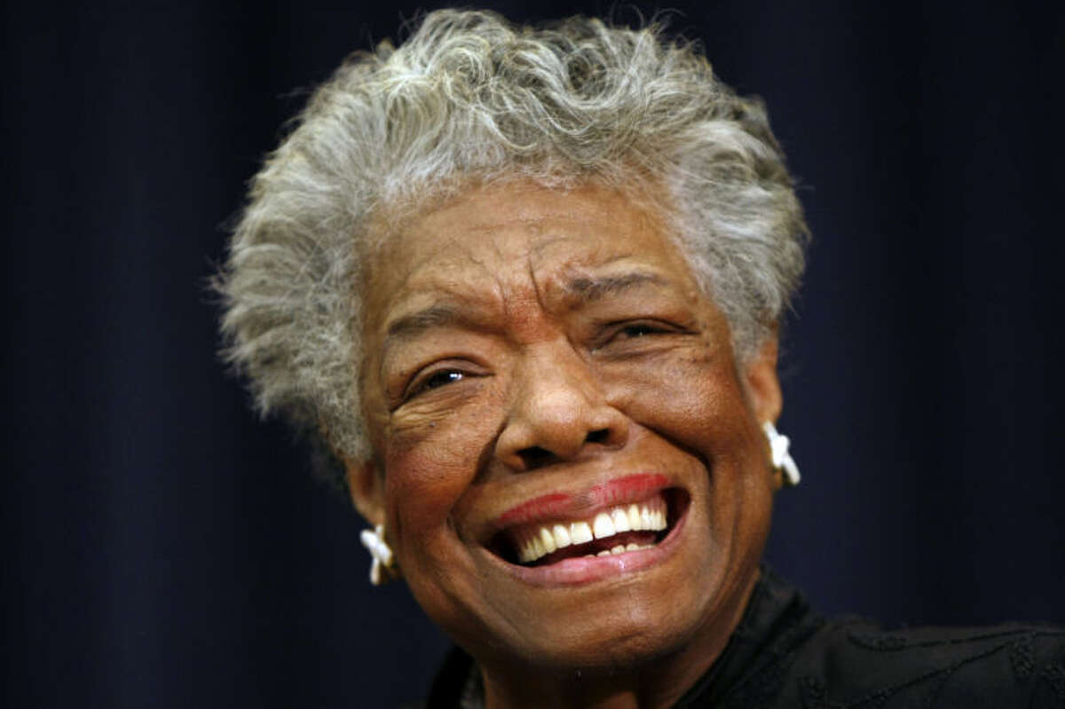 """FILE - In this Nov. 21, 2008 file photo, poet Maya Angelou is shown in Washington. Angelou will not attend the 2014 MLB Beacon Awards Luncheon where she will be honored due to issues with her health. Major League Baseball announced Friday, May 23, 2014 because of """"health reasons"""" the 86-year-old won't make it to the May 30 event in Houston before the annual Civil Rights Game. (AP Photo/Gerald Herbert,File)"""