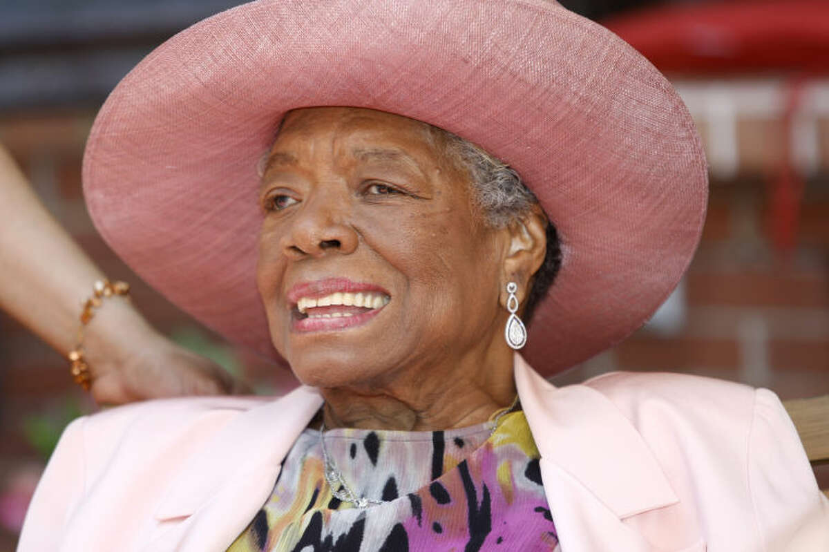 FILE - In this May 20, 2010, file photo, author Maya Angelou socializes during a garden party at her home in Winston-Salem, N.C. Angelou, author of