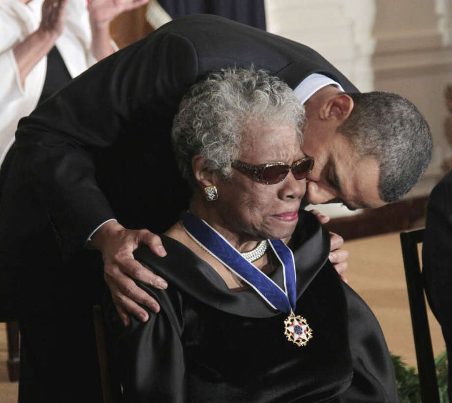 "FILE - In this Feb. 15, 2011 file photo, President Barack Obama kisses author and poet Maya Angelou after awarding her the 2010 Medal of Freedom during a ceremony in the East Room of the White House in Washington. Angelou, author of ""I Know Why the Caged Bird Sings,"" has died, Wake Forest University said Wednesday, May 28, 2014. She was 86. (AP Photo/Pablo Martinez Monsivais, File)"