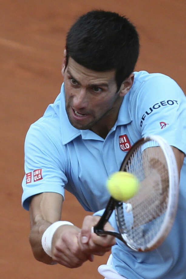 Serbia's Novak Djokovic returns the ball during the second round match of the French Open tennis tournament against France's Jeremy Chardy at the Roland Garros stadium, in Paris, France, Wednesday, May 28, 2014. (AP Photo/David Vincent)