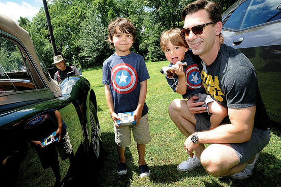 Jon Hammond with his sons Ben 6 and Dylan 2 enjoy the New England Auto Museum's Father's Day car show Sunday at Mathews Park. Hour photo/Matthew Vinci
