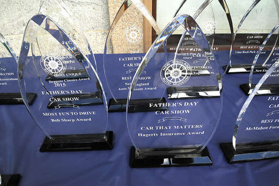 Awards on display at the New England Auto Museum's Father's Day car show Sunday at Mathews Park. Hour photo/Matthew Vinci