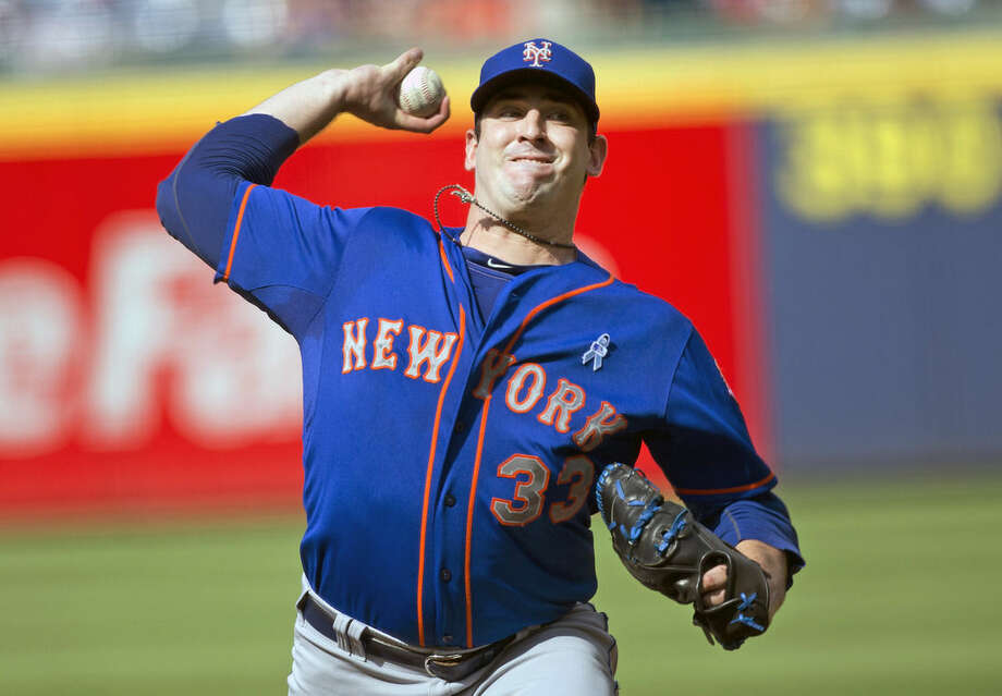 New York Mets starting pitcher Matt Harvey (33) works in the first inning of a baseball game against the Atlanta Braves, Sunday, June 21, 2015, in Atlanta. (AP Photo/John Bazemore)