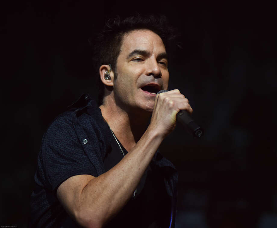 Hour photo/John Nash - Train played at Mohegan Sun Arena on Sunday night.