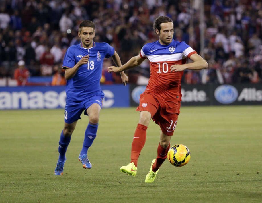 United States' Mix Diskerud, right, dribbles past Azerbaijan's Dimitrij Nazarov, left, during the second half of an international friendly soccer match on Tuesday, May 27, 2014, in San Francisco. United States won 2-0. (AP Photo/Marcio Jose Sanchez)