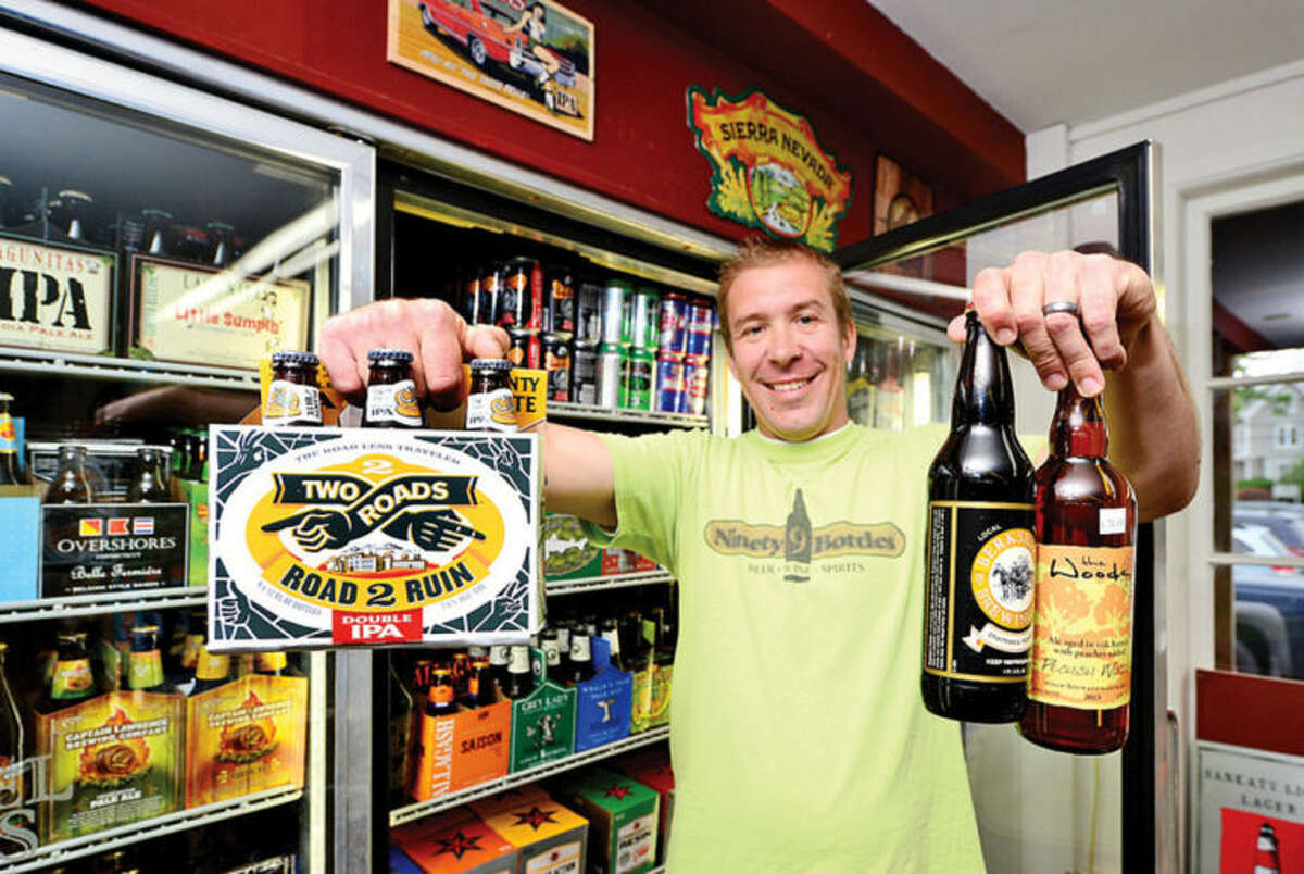 Hour photo / Erik Trautmann Sjur Soleng, owner of Ninety 9 Bottles at Bridge Sq. in Westportwill be hosting a craft beer festival at Oyster Shell Park in June.