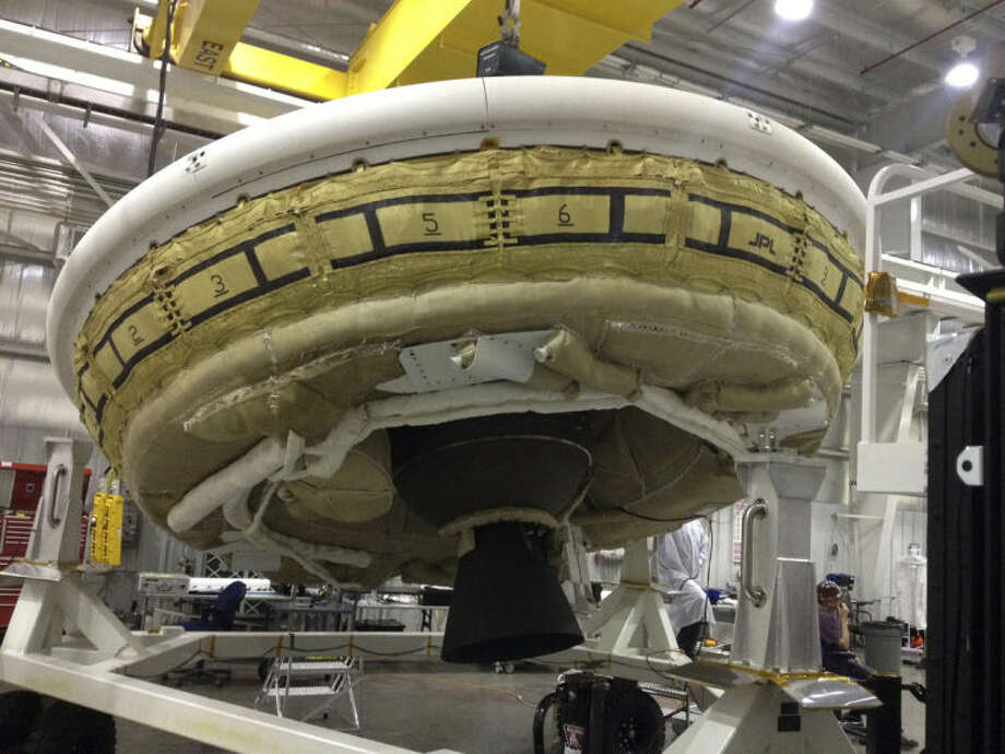 This undated image provided by NASA shows a saucer-shaped test vehicle holding equipment for landing large payloads on Mars in the Missile Assembly Building at the U.S Navy's Pacific Missile Range Facility at Kekaha on the island of Kaua'i in Hawaii. The vehicle, part of the Low Density Supersonic Decelerator project, will test an inflatable decelerator and a parachute at high altitudes and speeds over the Pacific Missile Range scheduled for June 1, 2014. (AP Photo/NASA)