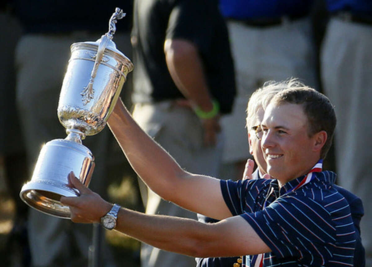 Jordan Spieth holds up the trophy after winning the U.S. Open golf tournament at Chambers Bay on Sunday, June 21, 2015 in University Place, Wash. (AP Photo/Matt York)
