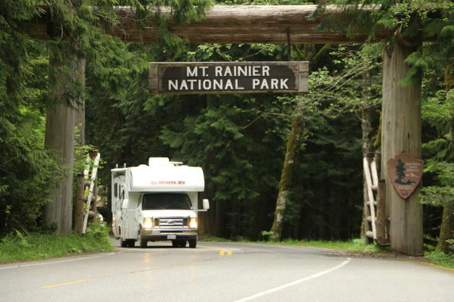 An RV is seen leaving Mount Rainier National Park in Washington state on Sunday, June 1, 2014. Park officials said that there are no immediate plans to recover the bodies of six climbers who likely fell thousands of feet to their deaths in the worst alpine accident on the mountain in decades. (AP Photo/Rachel La Corte)