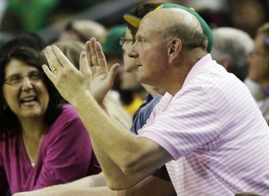 FILE - In this July 23, 2011 file photo, Microsoft Corp. CEO Steve Ballmer cheers during a charity basketball game in Seattle. For decades, Steve Ballmer has been Microsoft's biggest cheerleader with his big, booming voice and energetic high-fives, which are famous around Seattle. Now that he's agreed to buy the Los Angeles Clippers for $2 billion, the former CEO of the technology giant is expected to bring that boosterism to the hardwood down south. (AP Photo/Ted S. Warren, File)