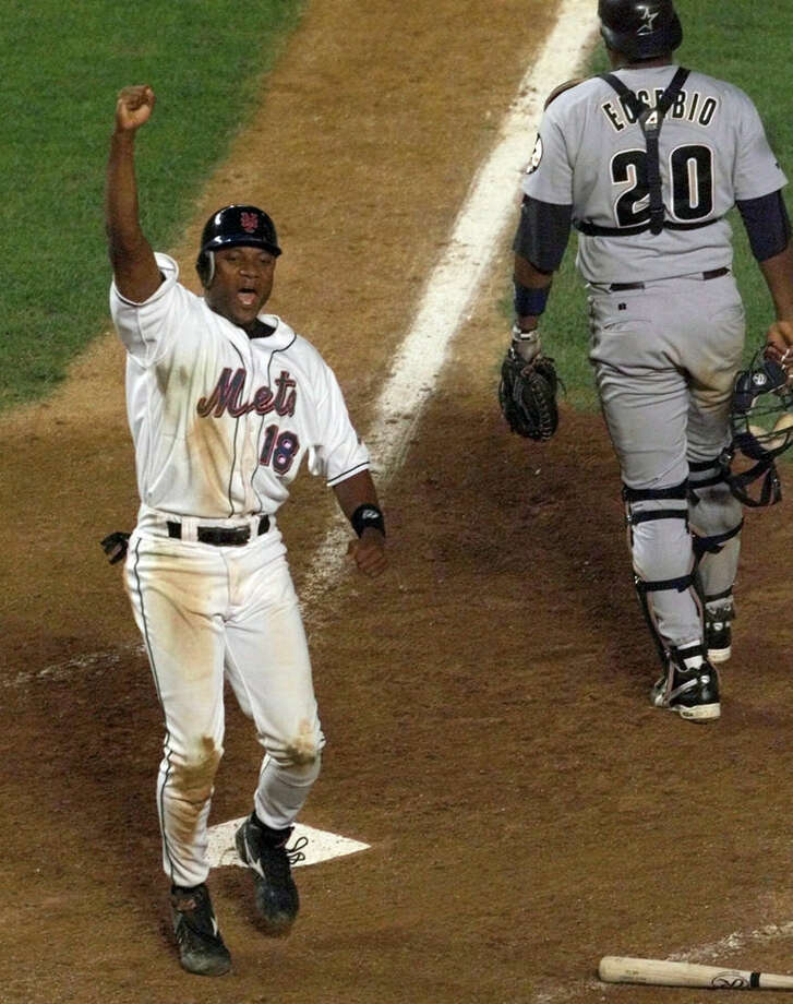 FILE - In this Aug. 23, 1999, file photo, New York Mets' Darryl Hamilton celebrates as he scores the game-winning run on a Matt Franco hit to left field in the bottom of the ninth inning that gave the Mets a 3-2 victory over the Houston Astros in a baseball game at Shea Stadium in New York. Authorities say Hamilton was killed Sunday, June 21, 2015, in a murder-suicide in the Houston suburb of Pearland, Texas. Pearland police say an initial investigation has determined Hamilton had been shot several times and that a woman in the home died of a self-inflicted gunshot wound. The woman was identified as Monica Jordan. (AP Photo/Ron Frehm, File)